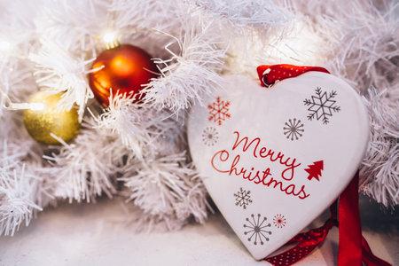 red christmas ball on tinsel