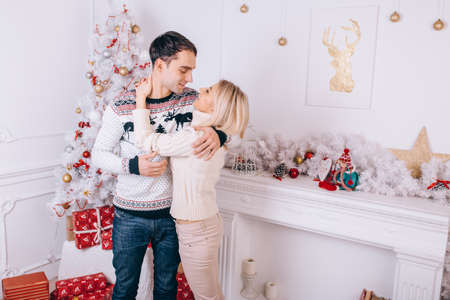 A happy family in love in the living room at Christmas