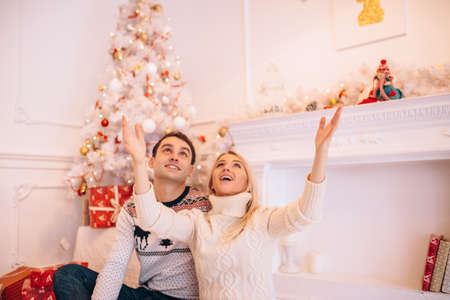 A couple in love celebrates Christmas in a living room