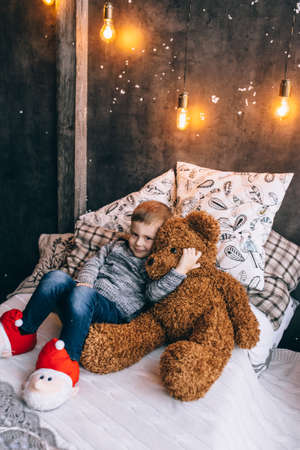 little boy and toy bear
