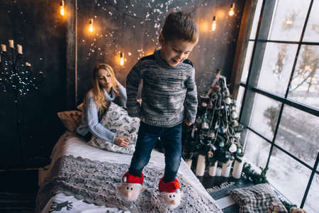 boy jumping on the bed