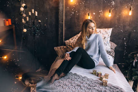 pretty girl sitting on the bed, portrait Stok Fotoğraf