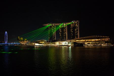 lazer: Singapore city, Singapore - July 17, 2016: The view to Marina Bay lazer show Editorial