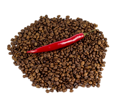red chili peppers on a black coffee beans