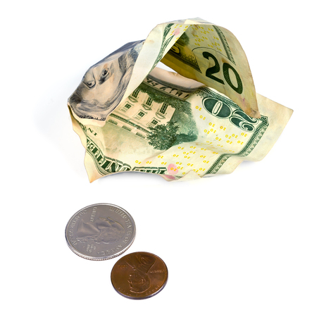 indebtedness: Crumpled dollars and small change on a white background