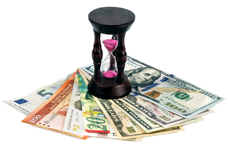 Currency of different countries and hourglass Stock Photo