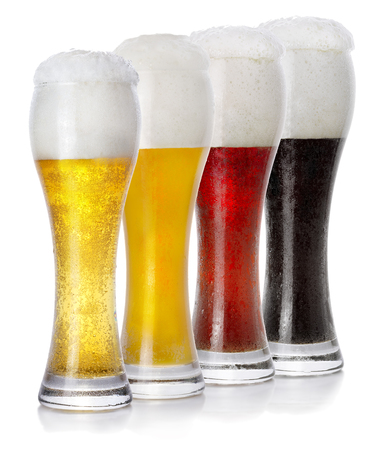 cup four: Four glasses of different fresh foamy beer
