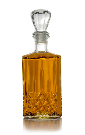 Carafe of good brandy on a white background