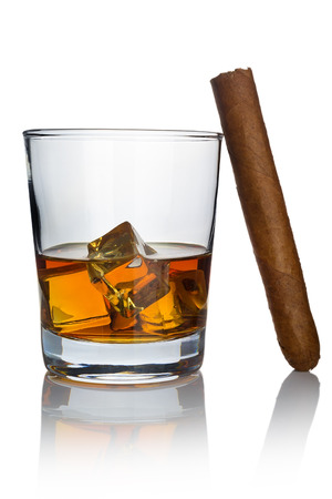 A glass of whiskey cooled with ice cubes and a smokeless cigar on a white background Standard-Bild