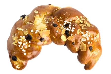 Fresh soft bun sprinkled with almond and raisins on a white background Stockfoto