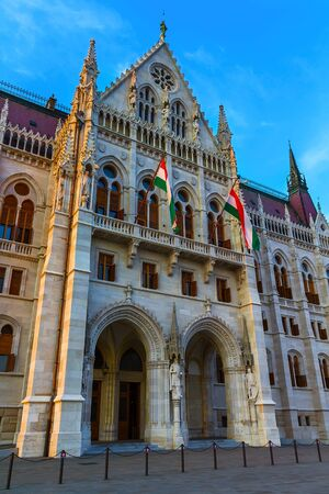 Hungarian Parliament in Budapest with two flags of Hungary Reklamní fotografie