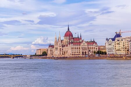 View of the Danube River, mountains and the Hungarian Parliament, Budapest.
