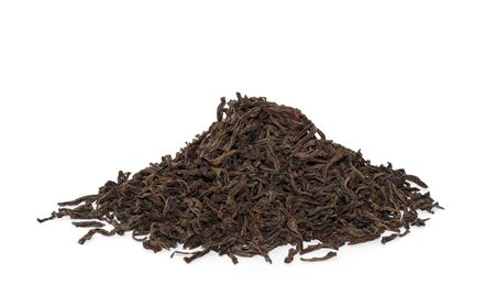 loose leaf: dry black tea leaves isolated on white Stock Photo