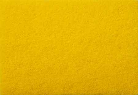 A close up of Yellow felt material background.