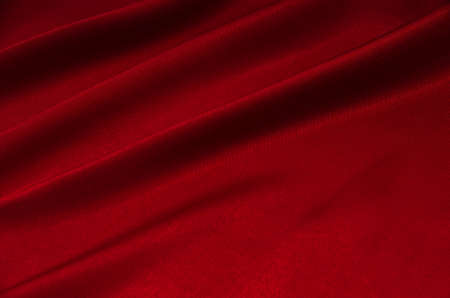 red satin or silk fabric as background 免版税图像