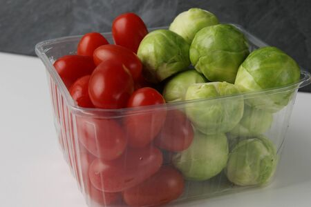 Brussels sprouts and cherry tomato in plastic box