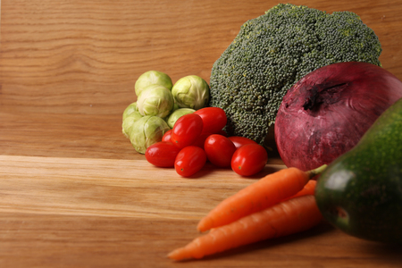 broccoli sprouts: Brussels sprouts, avocado, carrot, broccoli and cherry tomato on on the table