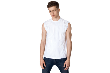Guy in casual style in white t-shirt and jeans on white background