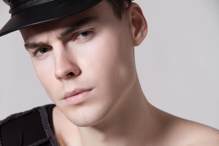 Beautiful strong face male model in fashion clothes on white isolated font background