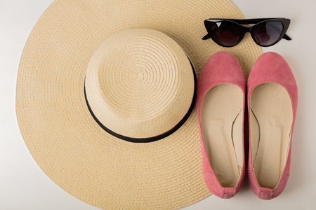 Womens summer accessories - hat, sunglasses and shoes (ballet flats). Selective focus. Stock Photo