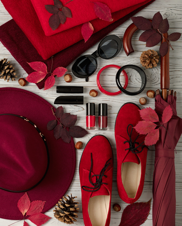 Fashion trend autumn winter. Clothing, shoes and accessories of different shades of red and crimson. Selective focus.