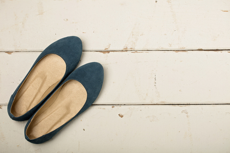 Blue womens shoes (ballerinas) on wooden background. Selective focus. Stockfoto