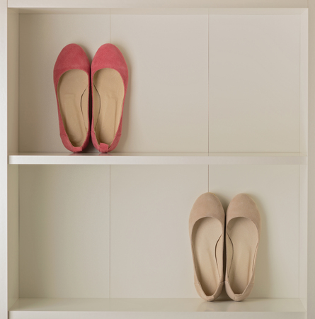 Womens shoes (ballet shoes) in the white wardrobe. Selective focus. 写真素材