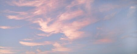 Beautiful pink clouds during sunset, blue sky with clouds background.