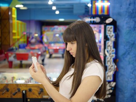 play popular: Girl play the popular smartphone game