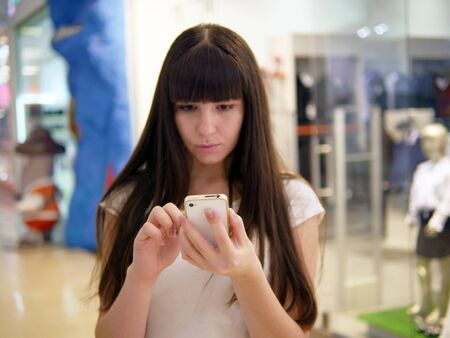 Girl play the popular smartphone game