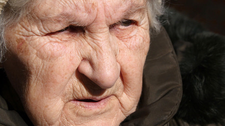 eyelids: Portrait of old talking woman. Close-up Stock Photo