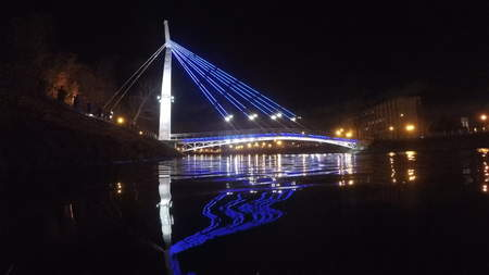 move in: Bridge with lights reflected in the water at night
