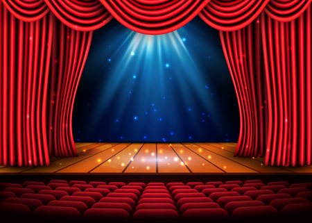 A theater stage with a red curtain and a spotlight and wooden floor.