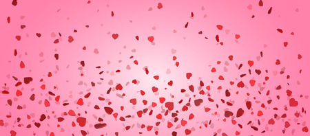 Heart confetti of Valentines petals falling on pink background. Flower petal in shape of heart confetti for Women's Day.