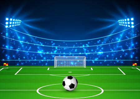 Football Stadium with a ball. Soccer field in the light of searchlights.