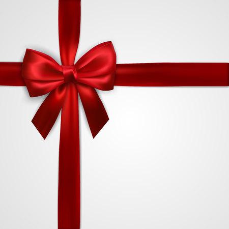 Realistyczna czerwona kokarda z poprzecznymi czerwonymi wstążkami na białym tle. Element dekoracji prezenty, pozdrowienia, święta. Ilustracja wektorowa.
