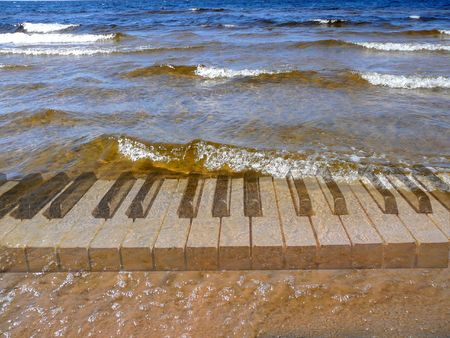 piano keyboard under surf waves Stock Photo