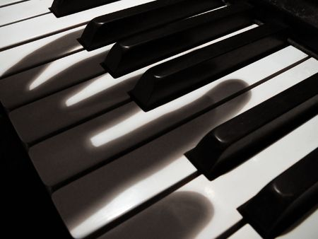 shadow fingers on piano keys