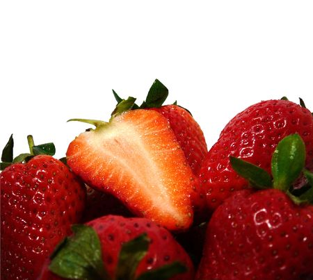 slit: macro red juicy strawberries background with slit one, isolated on white, contains clipping path