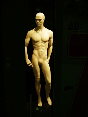 naked mannequin in dark shop window, total sale