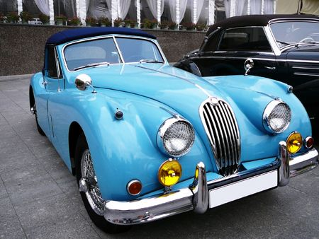 headlamp: vintage beautiful blue cabriolet parked on the street