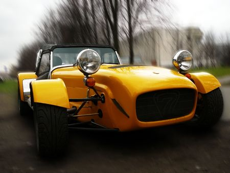 vintage yellow racing car on motion blur background