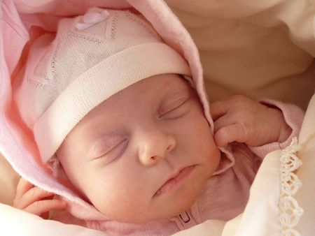 portrait sleeping newborn baby girl in knitted bonnet, wrapped soft blanket Stock Photo - 3190761
