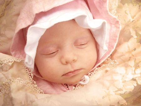 portrait of sweet dreaming baby girl framed apple-blossom texture
