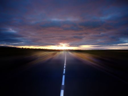 straight road under stormy sky with motion blur as speed effect photo