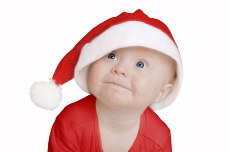 funny baby in big Santa Claus hat on white background Stock Photo