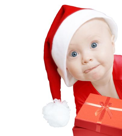 funny baby in Santa hat with present box on white background, space for text Stock Photo