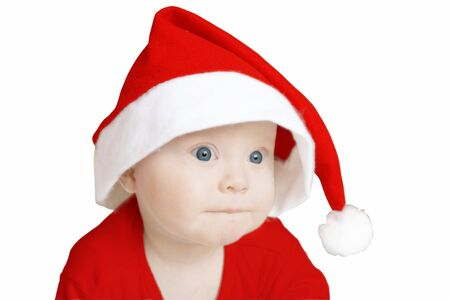 pensive baby in big Santa Claus hat on white background