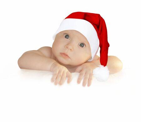 cute baby girl in Christmas hat holding empty blank board Banco de Imagens