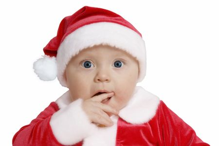 baby in Santa uniform in utter surprise, white background  photo